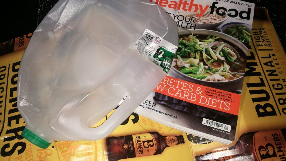 items of rubbish - plastic bottle, pizza box