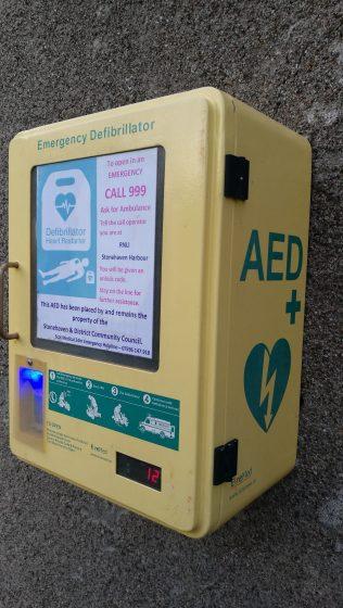 yellow defibrillator box