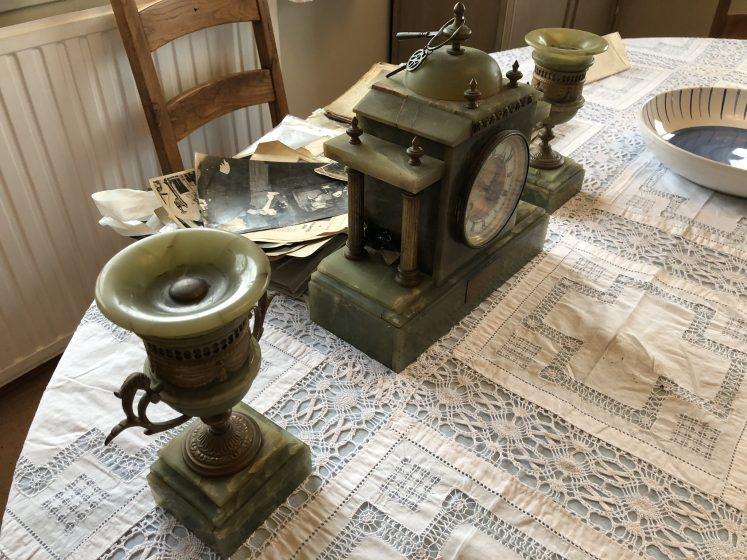 Old clock and pair of what looks like onynx goblets