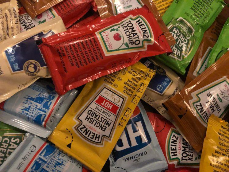 a jumble of sauce sachets - tomato ketchup, mayonnaise, brown sauce. Just need some chips