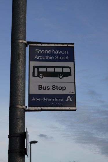 photo of bus stop sign