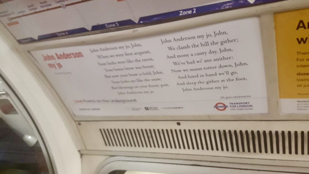 Words of poem on poster on london underground train