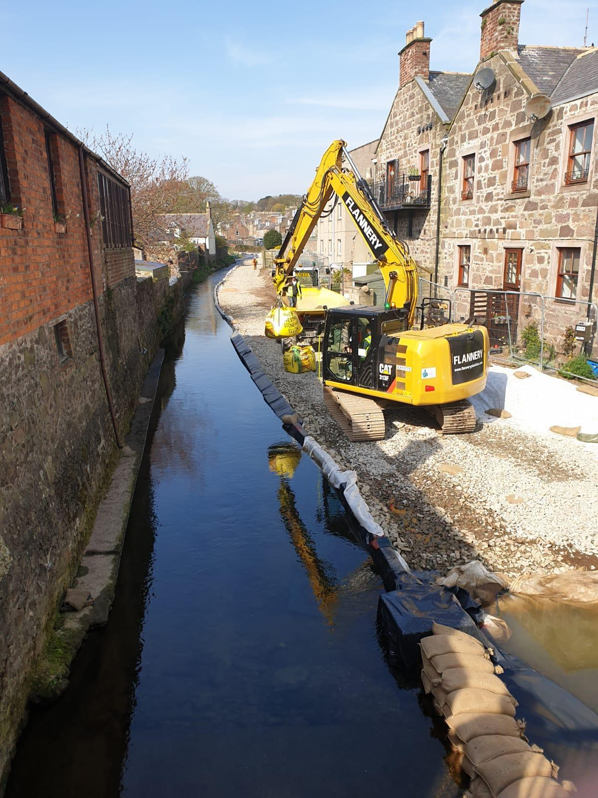 digger on hard standing built up at back of Cameron St properties. View from Road bridge