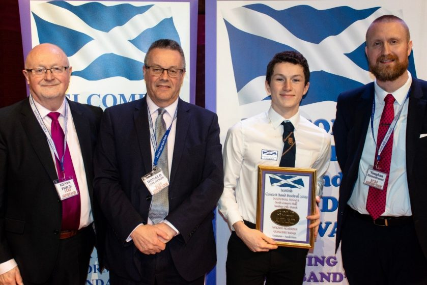 Mackie Pupil receiving award