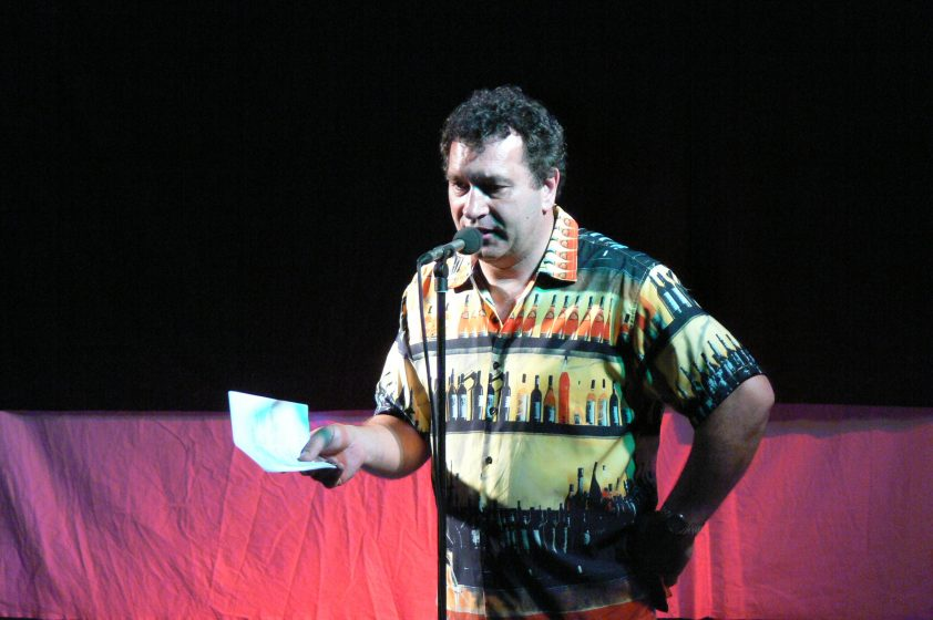 Martin on stage of Town Hall in very bright shirt