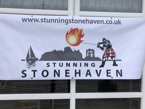 logo showing silhouettes of yacht, castle, war memorial and a colourful fireball swinger