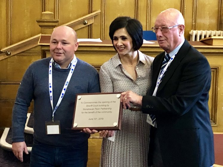 JIm Stephen, Andrea and John Robson with plaque