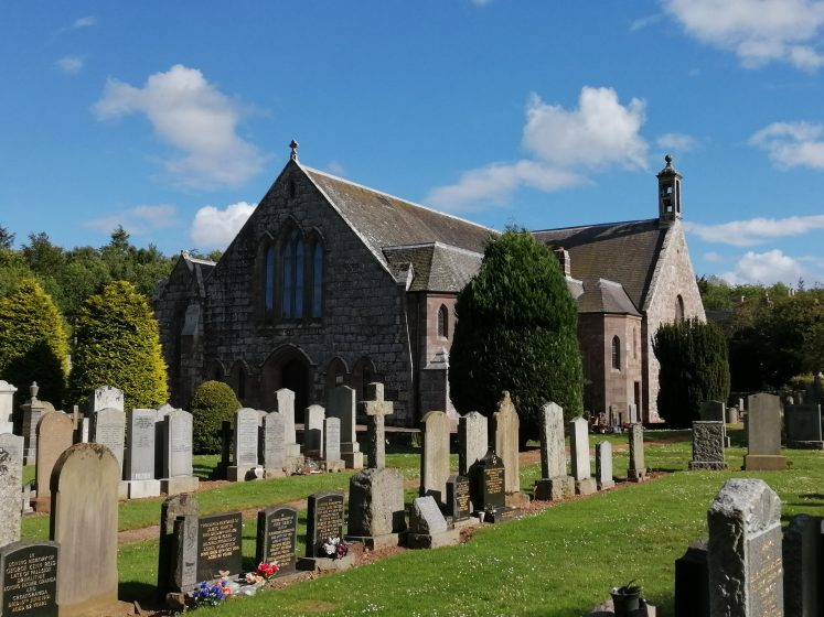 Dunnottar Church with gravestones in foreground