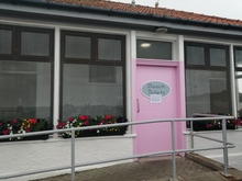 The two businesses take pride in the building which is freshly painted complete with pink door