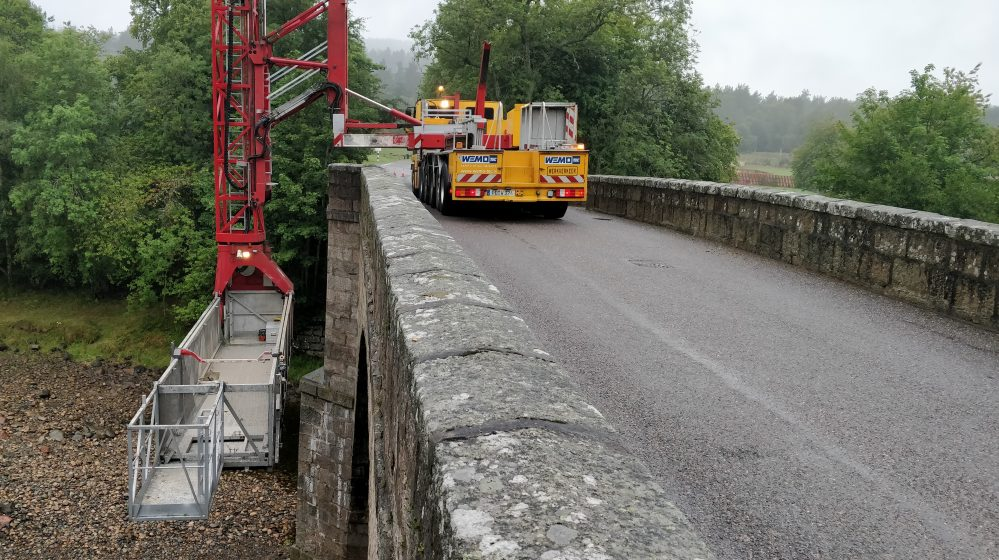 lorry with drop crane extension with working platform