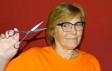 Linda holding pair of scissors
