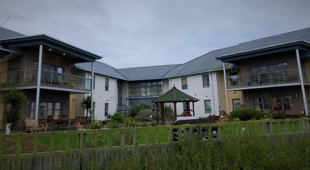 exterior shot of the care home with its modern styling and balconies