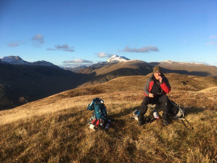 Hillwalker resting at summit