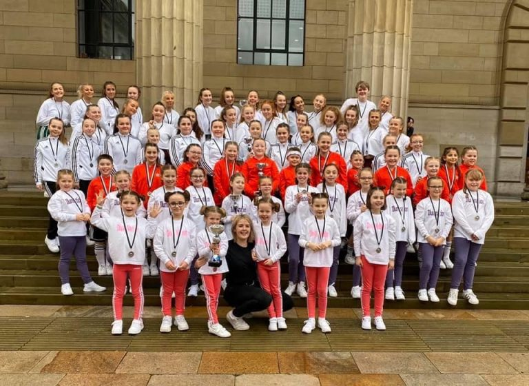 Large group of girls on Caird Hall steps