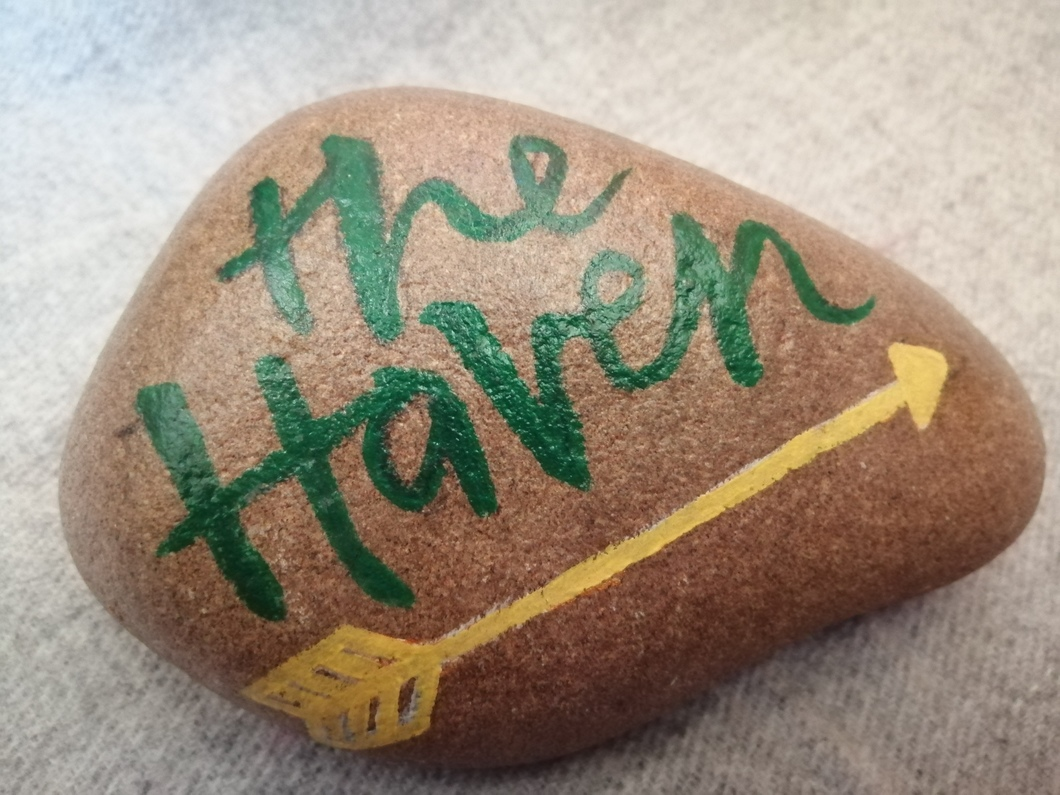 stone with The Haven painted on and an arrow