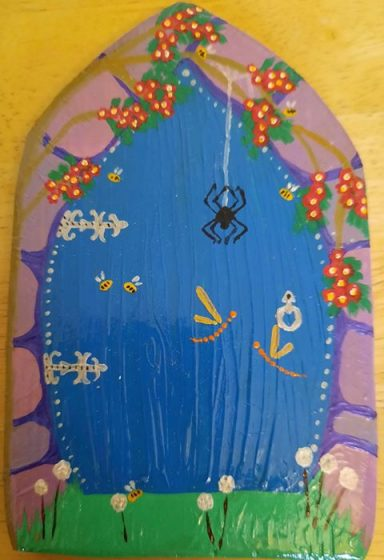 blue fairy door with spider