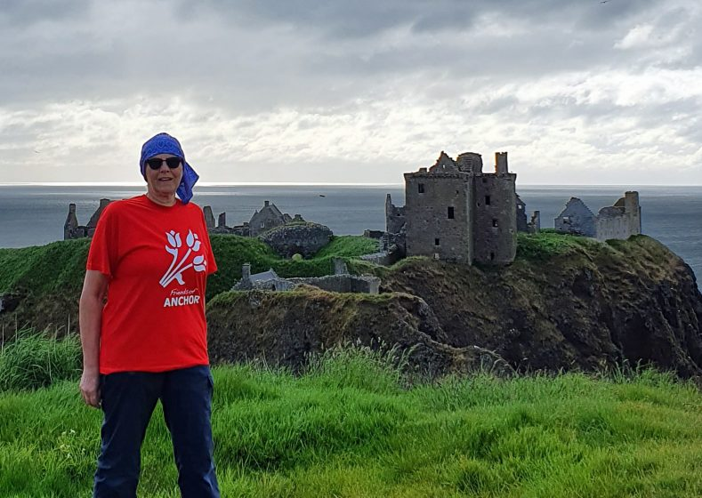 Linda at Dunnottar Castle - she wears a head scarf after treatment for cancer