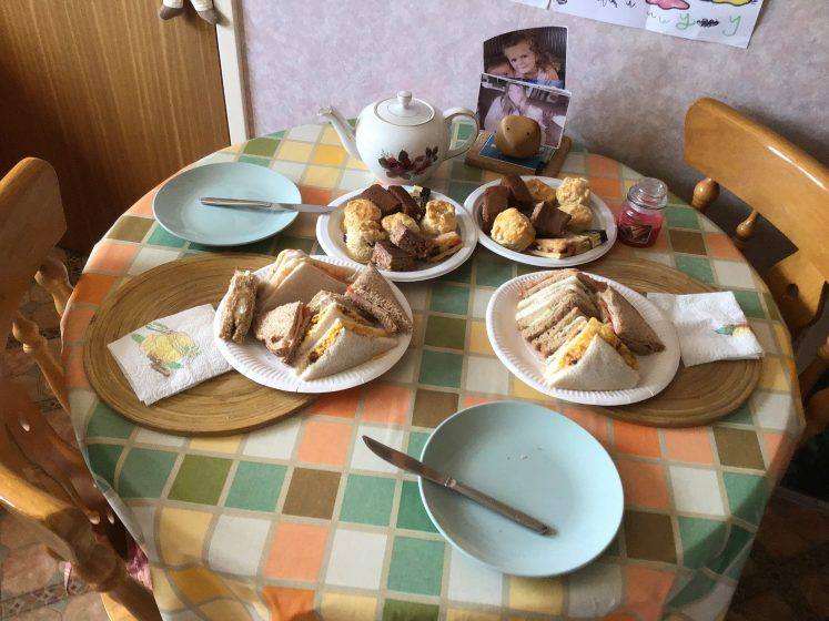 table set with cakes and sandwiches