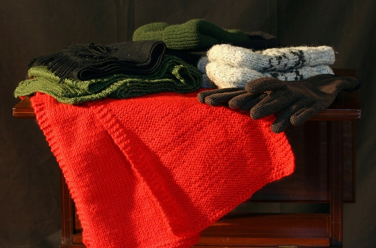 Examples of knitted hats,, scarves etc